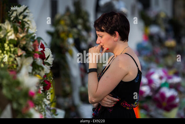 Veronica Nickolaisen, from Rock Hill, grieves in front of Emanuel AME Church. - Stock Image