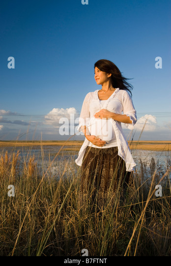 Prenatal Shoot in Everglades, lifestyle portrait - Stock Image