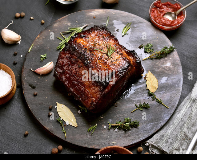 Bbq pork, grilled meat on wooden board - Stock Image