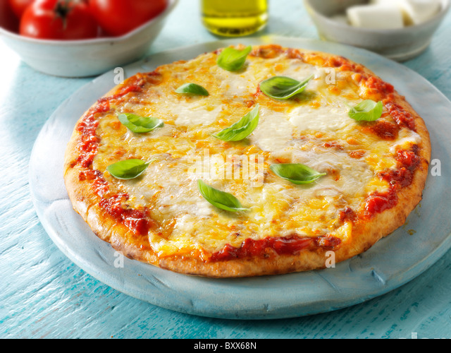 Pizza topped with 3 cheeses, & basil.n A Margarita Neopolitan Pizza. - Stock Image