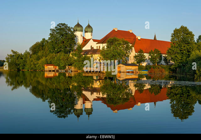 Benedictine Kloster Seeon monastery with monastery church of St. Lambert, Klostersee, Seebruck, Chiemgau, Upper - Stock Image