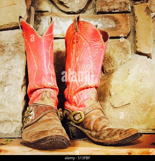 An old worn out pair of cowboy boots. - Stock Image