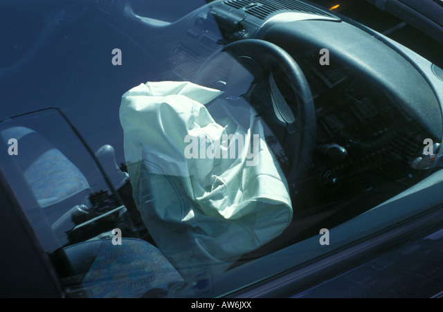 A deployed air bag in a car - Stock Image