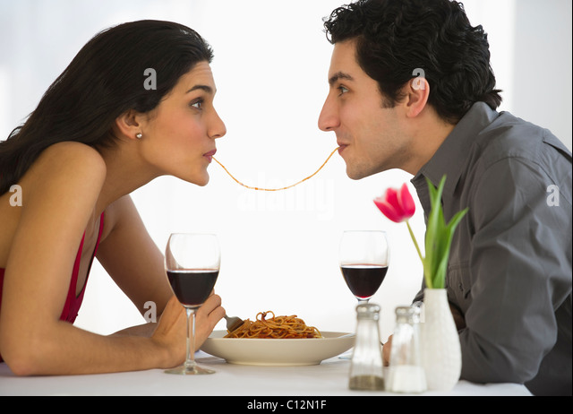 USA, New Jersey, Jersey City, Happy couple eating spaghetti together - Stock-Bilder