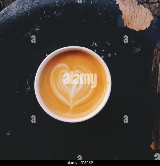 Cappuccino Coffee Cup With Latte Design - Stock Image