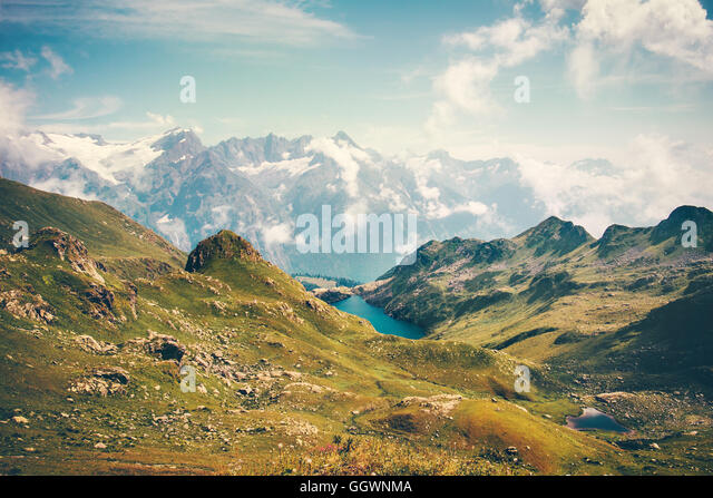 Lake and Mountains Landscape in Abkhazia with blue sky ad clouds Summer Travel serene scenic view of Greater Caucasus - Stock Image