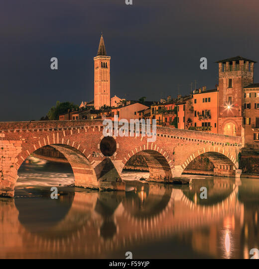 Ponte Pietra bridge at dusk over the Adige river in Verona, Italy - Stock Image