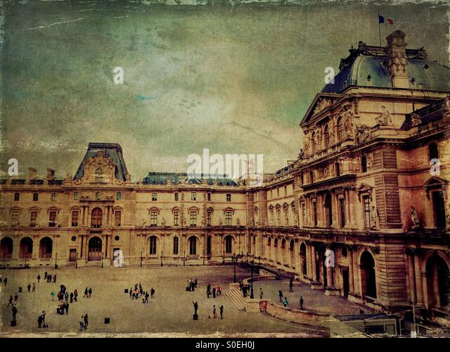 View of Musée du Louvre in Paris, France, taken from a second floor window. Tourists milling  below. Vintage - Stock Image