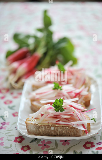 Radish Toasts with Salted Butter - Stock Image