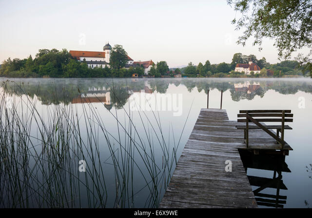 Early morning at Seeon Abbey on an island in Seeoner See Lake, Seeon-Seebruck, Chiemgau, Upper Bavaria, Bavaria, - Stock Image
