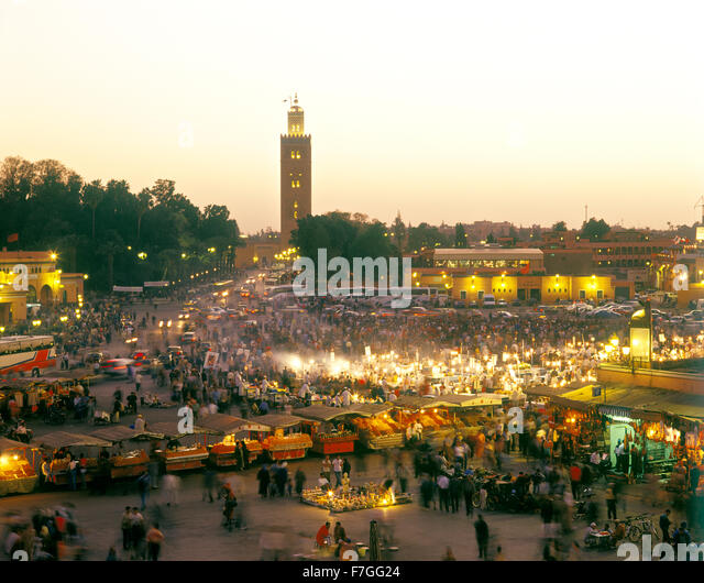 A view of food stalls in the marketplace and public square Place Jema al Fna in Marrakech during dusk. Marrakech, - Stock Image