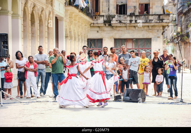 HAVANA, CUBA - JANUARY 1, 2013 Local kids in traditional outfits perform dancing and singing on street in Old Havana, - Stock Image
