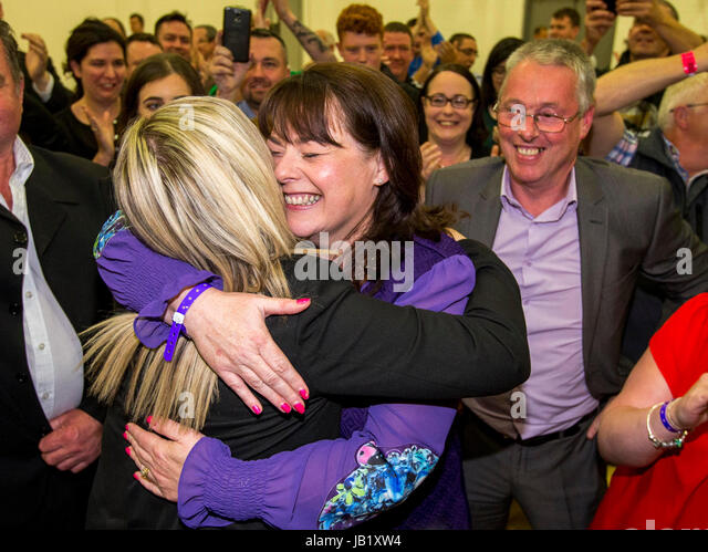 Newly elected Sinn Fein Fermanagh & South Tyrone MP Michelle Gildernew (centre) is embraced on by Michelle - Stock Image