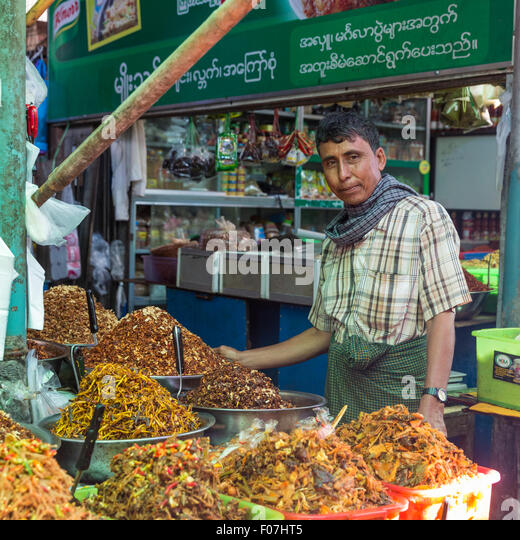 Spice and prepared food merchant at food market, Pyin Oo Lwin, Myanmar - Stock Image