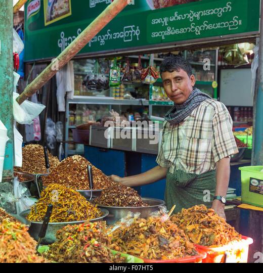 Spice and prepared food merchant at food market, Pyin Oo Lwin, Myanmar - Stock Image