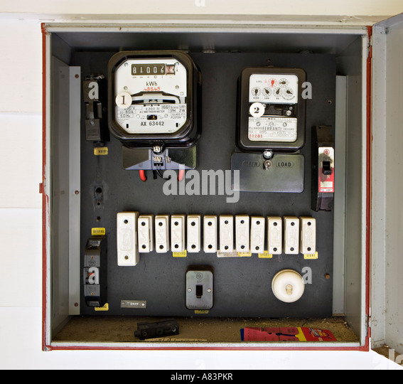 Electricity meter in box with old style fuses, circa 1962, in New Zealand home - Stock Image