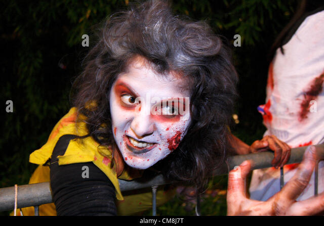 Zombie entertain crowds in the Zombie Garden at Fright Night, Britain's biggest Halloween carnival, Sheffield, - Stock Image