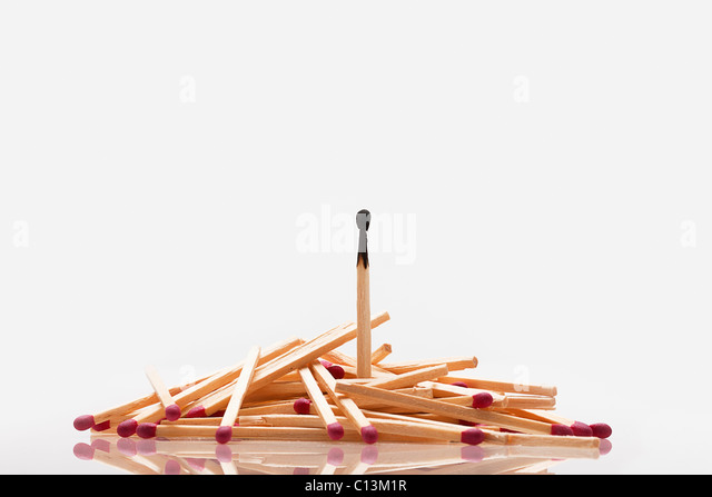 Pile of matches with one burned inside - Stock Image