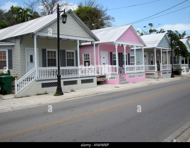Row of pastel coloured wooden houses in Key West Florida - Stock Image