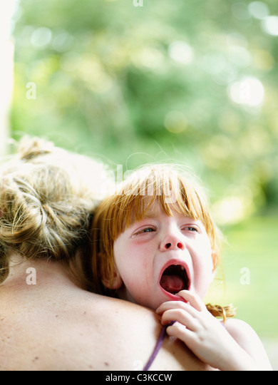 Mother consoling crying daughter - Stock-Bilder