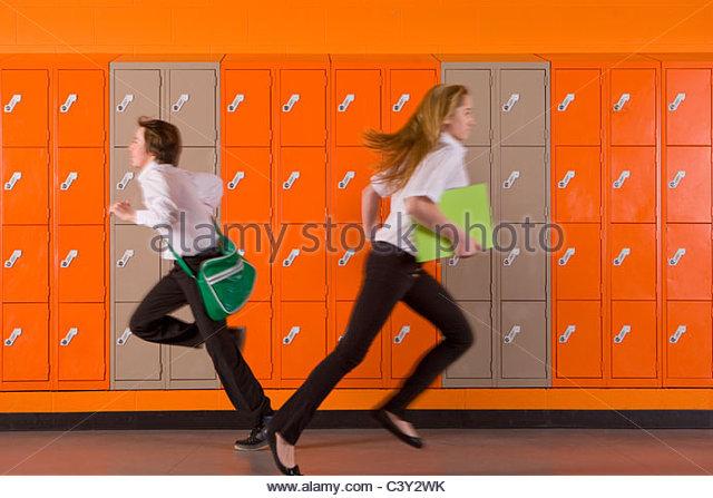 Students rushing past school lockers - Stock-Bilder