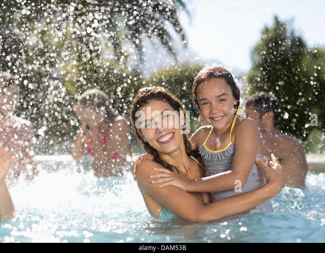 Mother and daughter in swimming pool - Stock Image