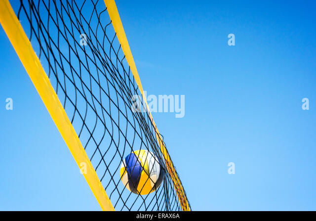 Beach volleyball caught in the net. - Stock Image
