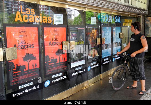 Buenos Aires Argentina Avenida de Mayo cinema movie theater theatre feature film door Hispanic man. cyclist bicycle - Stock Image