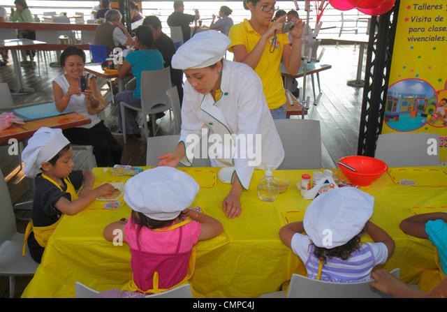 Peru Lima Miraflores Malecon de la Reserva Larcomar shopping center centre cooking class demo Hispanic woman girl - Stock Image