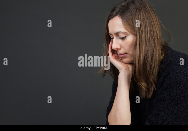 Woman, sad, depressions, worries - Stock Image