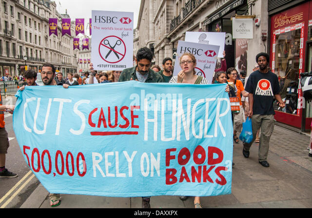 London, UK. 20th July, 2013. Protesters march along Regents Street as UK Uncut hold demonstrations outside two London - Stock Image