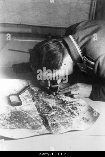 German soldier analyses reconnaissance images, 1941 - Stock Image
