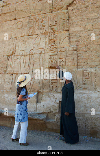 Tourist, Temple of Luxor, Thebes, UNESCO World Heritage Site, Egypt, North Africa, Africa - Stock Image