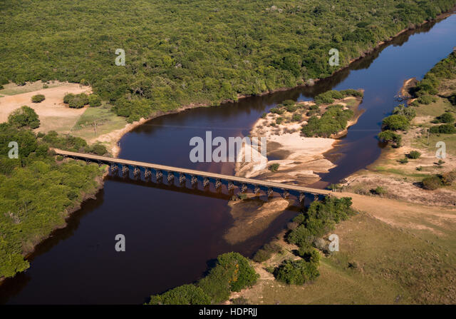 A bridge over the Rio Negro in Mato Grosso do Sul, Brazil, in the heart of the Pantanal, during the dry season. - Stock Image