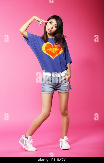 Asian Unhappy Woman Gesturing with his Finger against her Temple - Stock Image