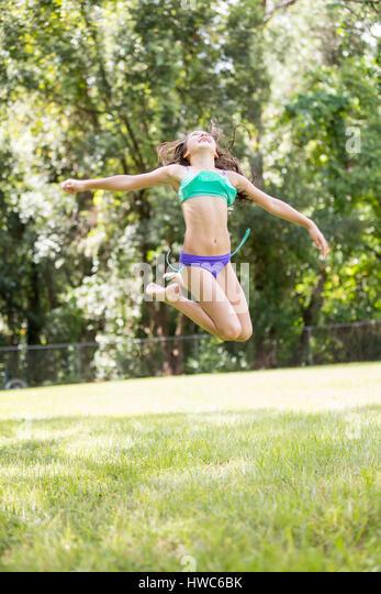 Girl playing in backyard - Stock Image