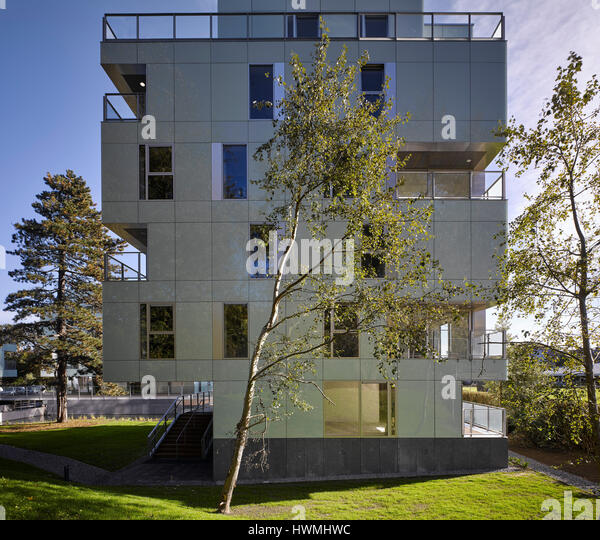View of exterior facade showing landscape. Dunluce Apartments, Ballsbridge, Ireland. Architect: Derek Tynan Architects, - Stock-Bilder