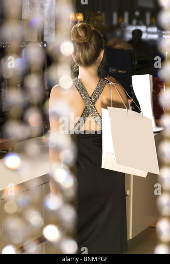 back of beautiful rich lady in the boutique - Stock Image