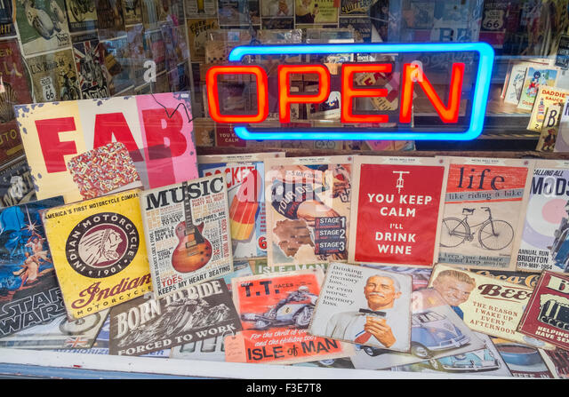 Shop window display of nostalgic posters, with neon 'Open' sign. - Stock-Bilder