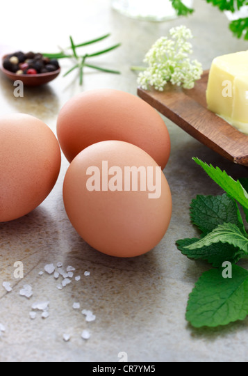 Eggs butter and herbs - Stock Image