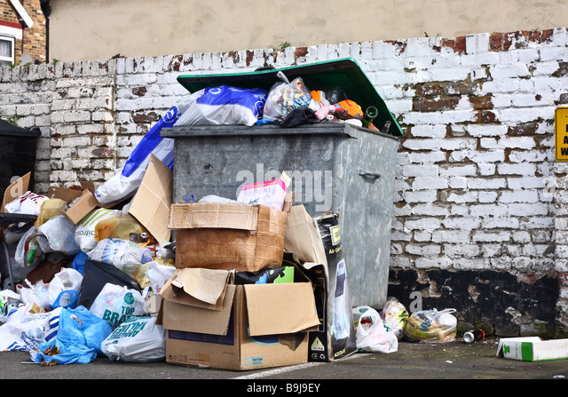 Overflowing rubbish bin in london stock photos overflowing rubbish bin in london stock images - Rd rubbish bin ...