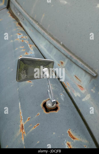 Close up detail of rusty decayed Morris Minor motor vehicles, UK - Stock Image
