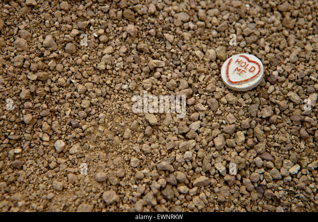Love Heart sweet on the ground - Stock Image