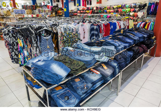 Coimbra Portugal historic center downtown store clothing jeans shopping jeans display - Stock Image