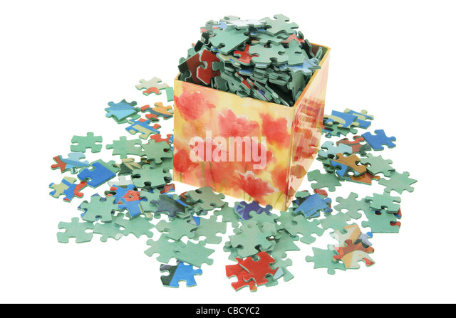 Jigsaw Puzzle Pieces in Box - Stock Image