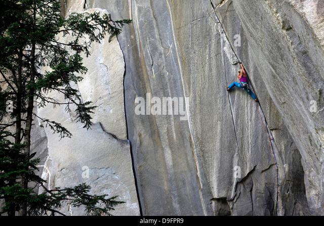 A climber scales cliffs at Cadarese, northern Italy - Stock Image