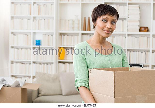 Woman with cardboard box - Stock Image