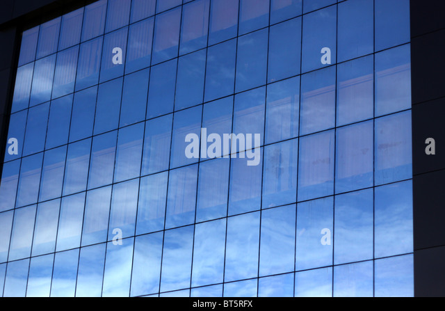 Office building with blue glass and reflection of sky - Stock-Bilder