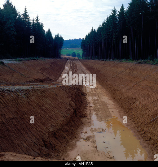 Road construction trough forest land Bavaria Germany. Photo by Willy Matheisl - Stock Image