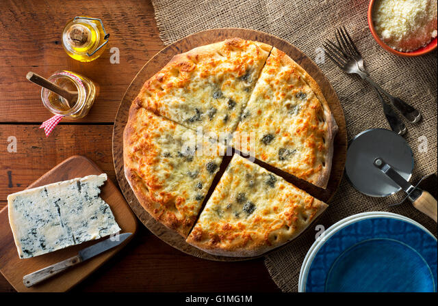 A delicious home made gourmet pizza with gorgonzola blue cheese. - Stock Image